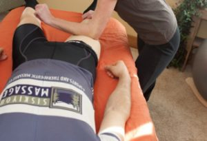Image of cyclist receiving sports massage to improve performance