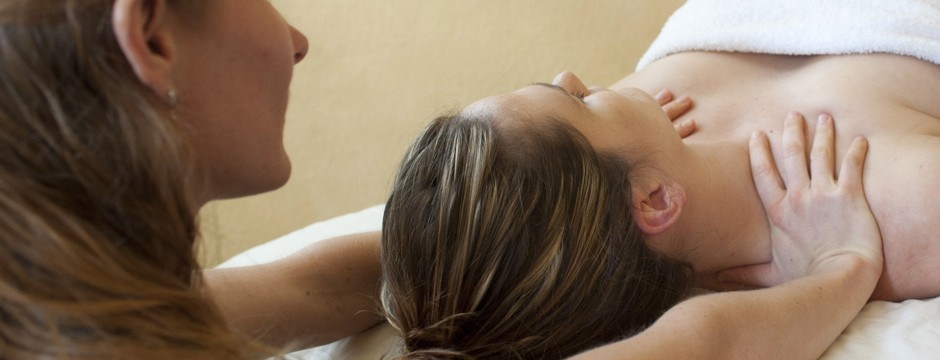 Image of massage therapy to reduce tension from work related stress.